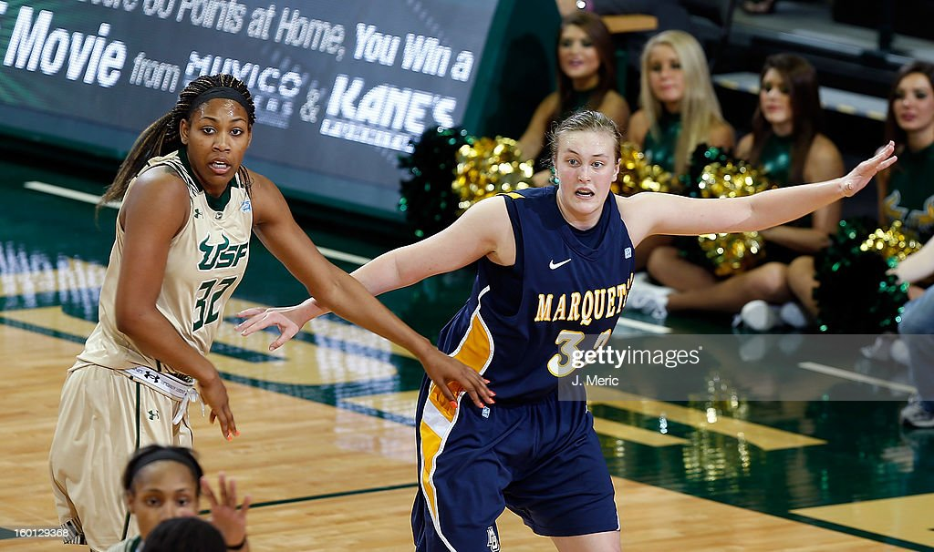 Lauren Tibbs #32 of the Marquette Golden Eagles calls for the ball as Akila McDonald #32 of the South Florida Bulls defends during the game at the Sun Dome on January 26, 2013 in Tampa, Florida.