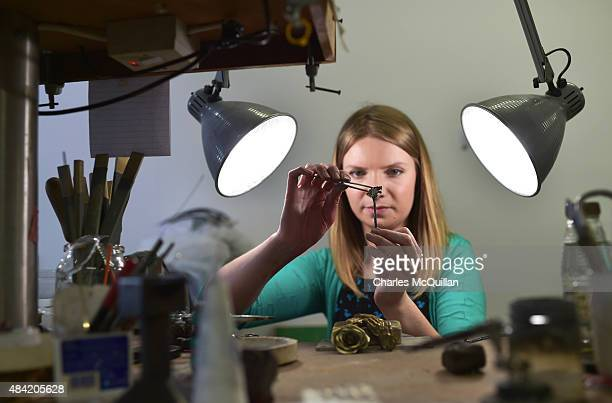 Lauren Wethers a goldsmith at Steensons jewellers in Glenarm puts the finishing touches to a Game of Thrones Dire Wolf sterling silver brooch pin on...