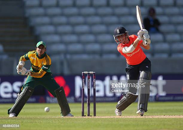 Lauren Winfield of England in action batting as Trisha Chetty of South Africa looks on during the NatWest Women's International T20 match between...