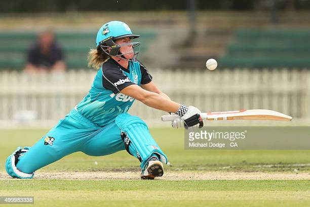 Lauren Winfield of the Heat is caught out after slipping while hitting the ball during the Women's Big Bash League match between the Brisbane Heat...