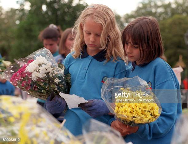 Lauren Wright aged 10 and Caroline Gillingham aged 11 of Woodford Green Girl Guides join in the mammoth task of sorting the thousands of tributes...