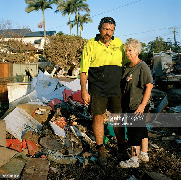 Laurena Hooker with husband Glenn Teale and a pile of their destroyed possessions in Rocklea Once the water started coming in it just kept coming it...