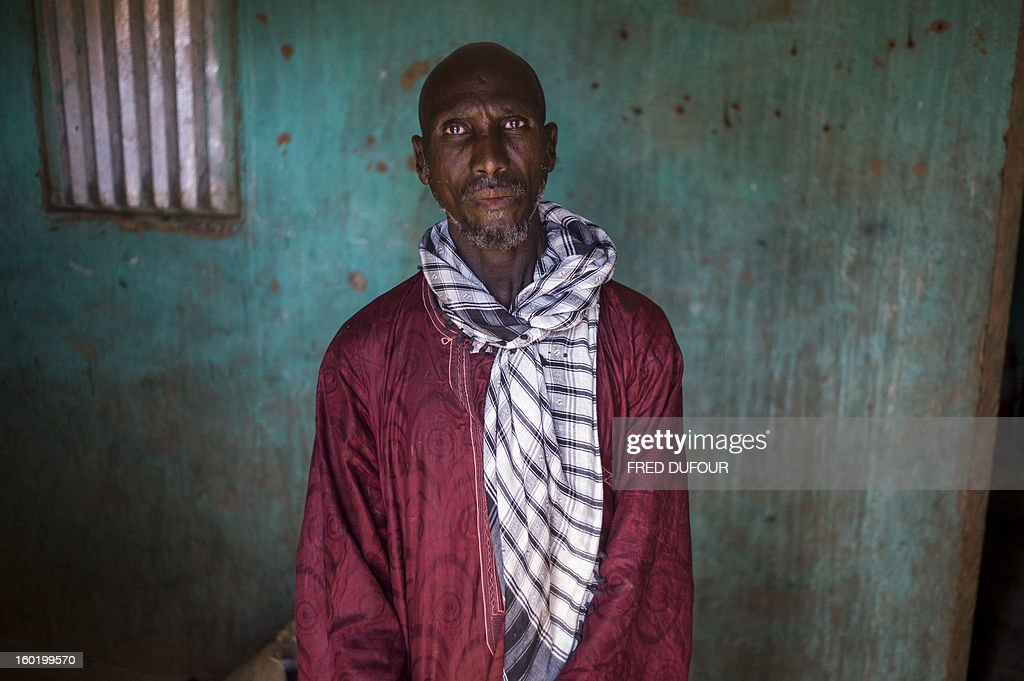 Laurence BOUTREUX - Idrissa Maiga, a Malian farmer, poses in his house in Konna on January 27, 2013. Maiga's second wife, 41, and two boys and a girl aged from 10 to 14 reportedly perished on the morning of the 11 January during a French army air raid and were buried the same afternoon. AFP PHOTO / FRED DUFOUR