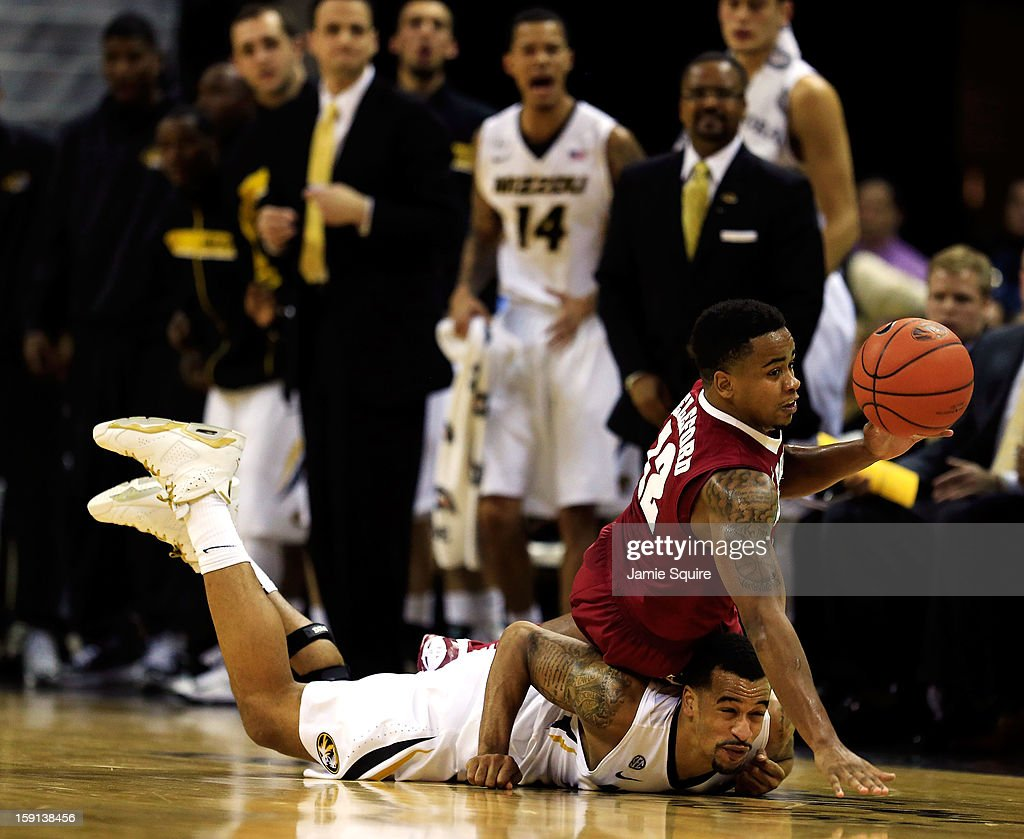 Laurence Bowers #21 of the Missouri Tigers and Trevor Releford #12 of the Alabama Crimson Tide scramble for a loose ball during the game at Mizzou Arena on January 8, 2013 in Columbia, Missouri.