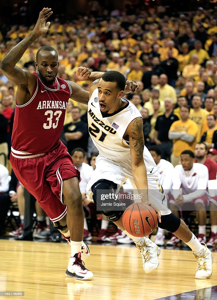 Laurence Bowers #21 of the Missouri Tigers drives toward the basket as Marshawn Powell #33 of the Arkansas Razorbacks defends during the game at Mizzou Arena on March 5, 2013 in Columbia, Missouri.