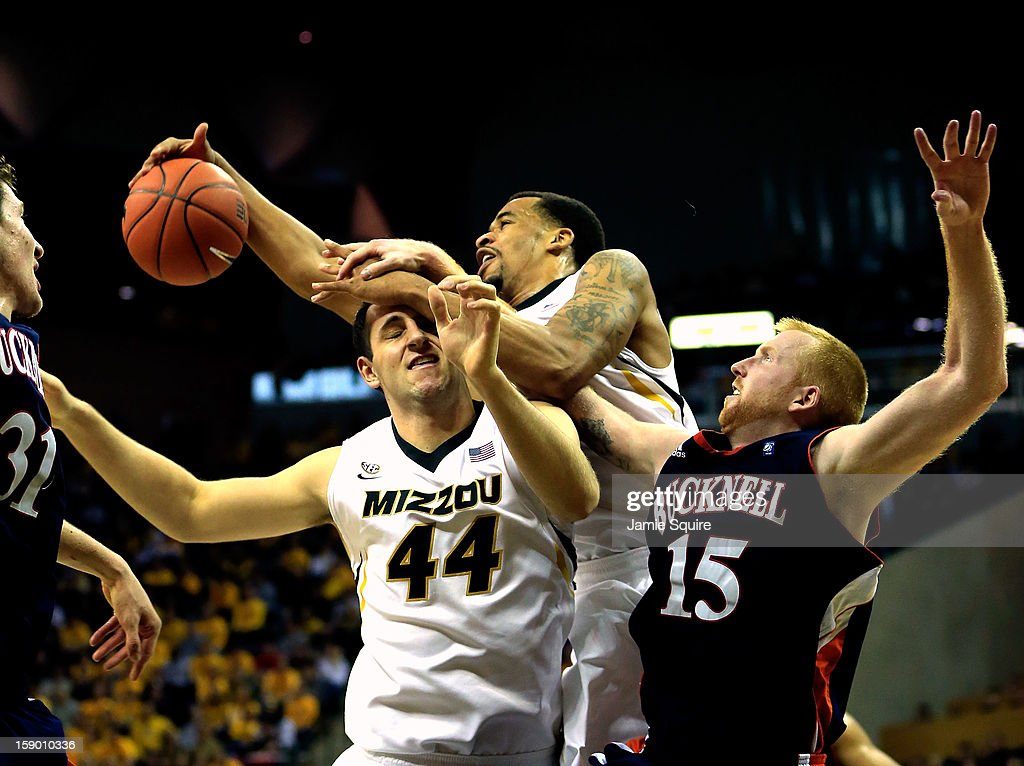 Laurence Bowers #21 of the Missouri Tigers grabs a rebound over Ryan Rosburg #44 and Joe Willman #15 of the Bucknell Bison during the game at Mizzou Arena on January 5, 2013 in Columbia, Missouri.
