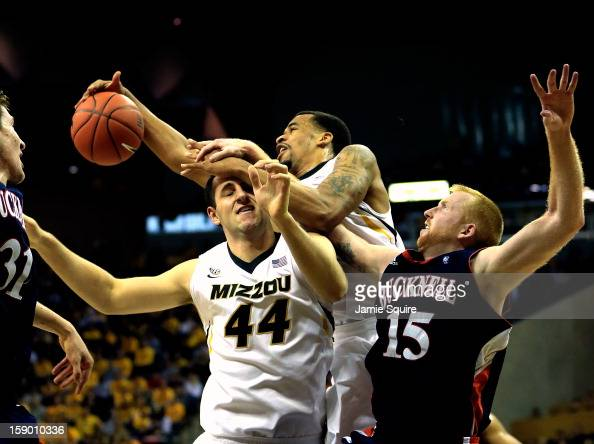 Laurence Bowers of the Missouri Tigers grabs a rebound over Ryan Rosburg and Joe Willman of the Bucknell Bison during the game at Mizzou Arena on...
