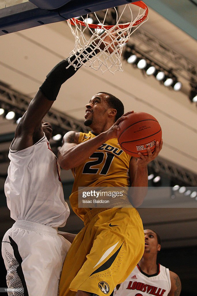 Laurence Bowers #21 of the Missouri Tigers shoots against Gorgui Dieng #10 of the Louisville Cardinals during the Battle 4 Atlantis tournament at Atlantis Resort November 23, 2012 in Nassau, Paradise Island, Bahamas.