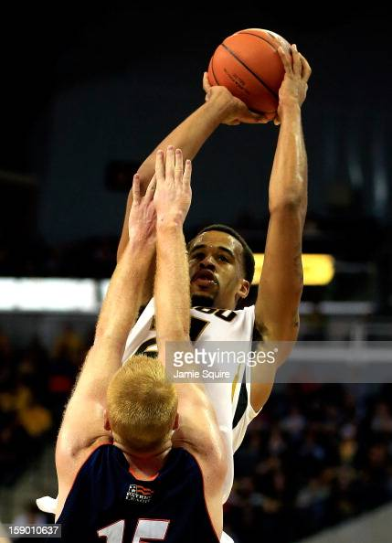 Laurence Bowers of the Missouri Tigers shoots over Joe Willman of the Bucknell Bison during the game at Mizzou Arena on January 5 2013 in Columbia...