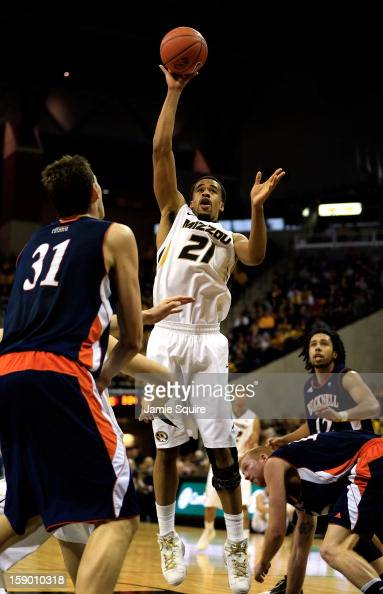 Laurence Bowers of the Missouri Tigers shoots over Mike Muscala of the Bucknell Bison during the game at Mizzou Arena on January 5 2013 in Columbia...
