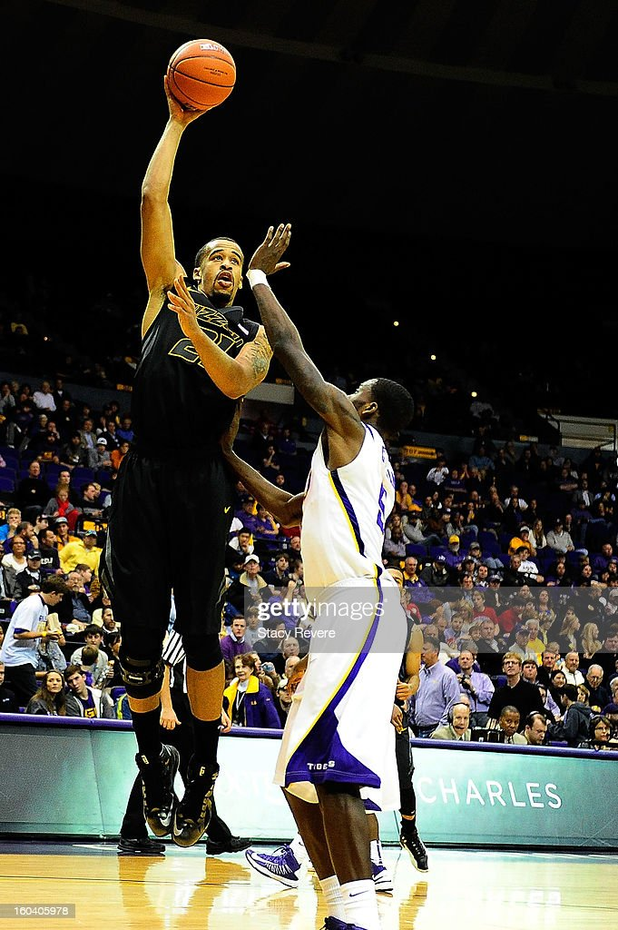 Laurence Bowers #21 of the Missouri Tigers shoots over Shavon Coleman #5 of the LSU Tigers during a game at the Pete Maravich Assembly Center on January 30, 2013 in Baton Rouge, Louisiana. LSU won the game 73-70.