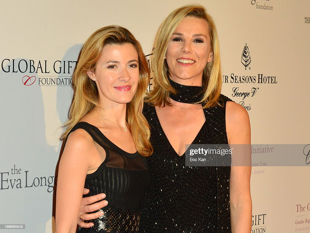 Laurence Ferrari (R) and a TV presenter attend the Eva Longoria Presents 'Global Gift Gala' 2013 - Photocall at the Hotel Four Season GeorgesV on May 13, 2013 in Paris, France.