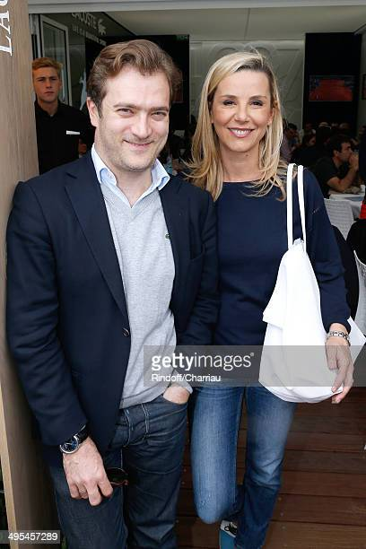 Laurence Ferrari and her companion Renaud Capucon attend the Roland Garros French Tennis Open 2014 Day 10 on June 3 2014 in Paris France