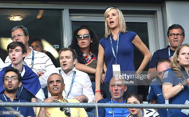 Laurence Ferrari and her husband Renaud Capucon react during the UEFA Euro 2016 final between Portugal and France at Stade de France on July 10 2016...