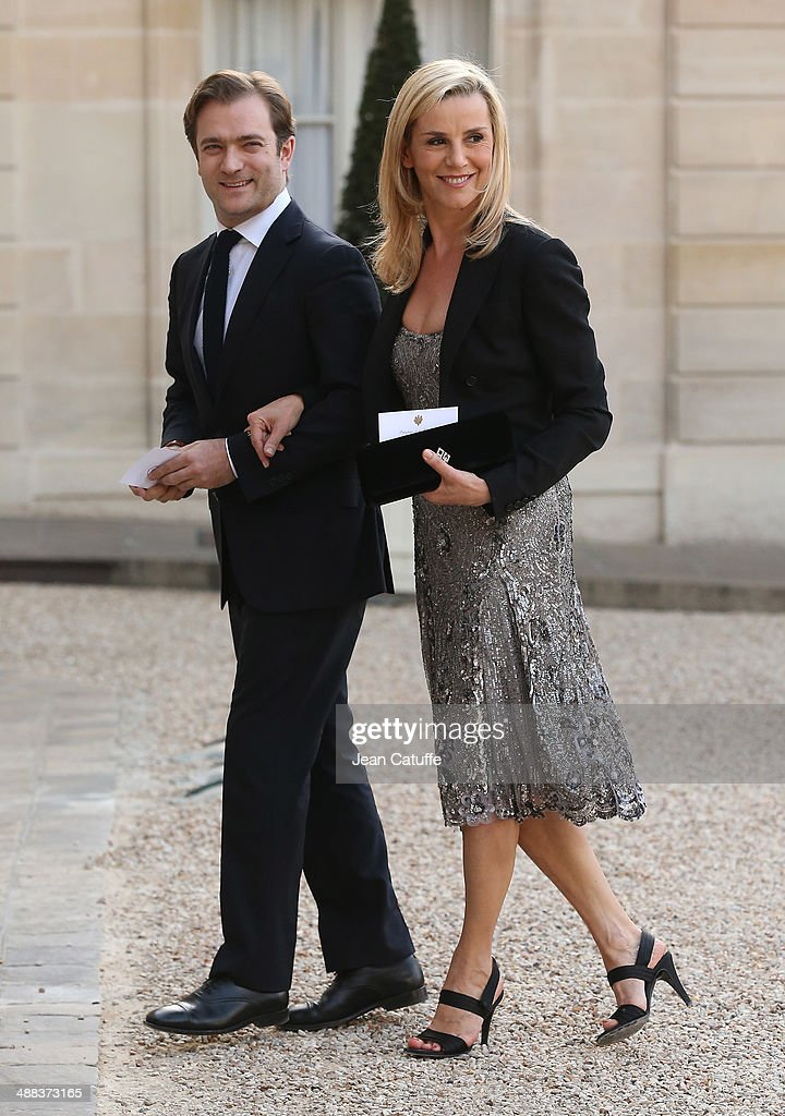 Laurence Ferrari and husband Renaud Capucon arrive at the State Dinner honoring Japanese Prime Minister at Elysee Palace on May 5 2014 in Paris France