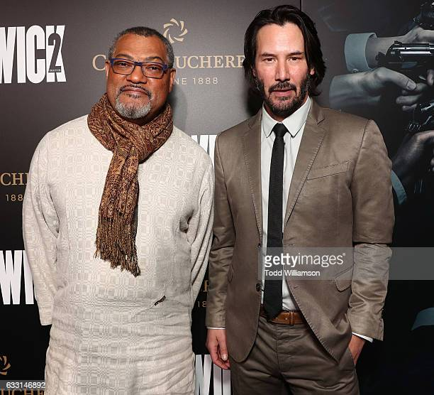 Laurence Fishburne and Keanu Reeves attends the Premiere Of Summit Entertainment's 'John Wick Chapter Two at ArcLight Hollywood on January 30 2017 in...