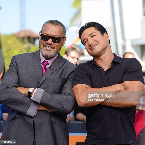 Laurence Fishburne and Mario Lopez visit 'Extra' at Universal Studios Hollywood on September 9 2014 in Universal City California