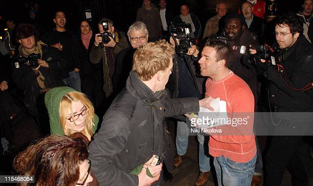 Laurence Fox stands in front of Billie Piper to protect her from a drunk who tried to manhandle her outside the Garrick Theatre