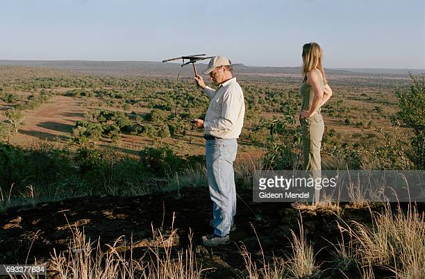 Laurence Frank and Alayne Mathieson are predator biologists Here they use an electronic tracking system to find a lion that lives on Mugie Ranch in...