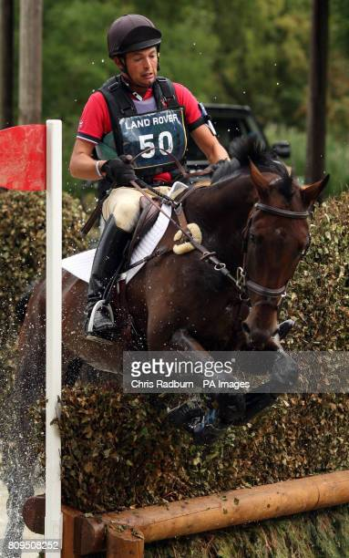 Laurence Hunt on Phoebus as they pass through the Trout Hatchery in the Cross Country Event during The Land Rover Burghley Horse Trials Stamford