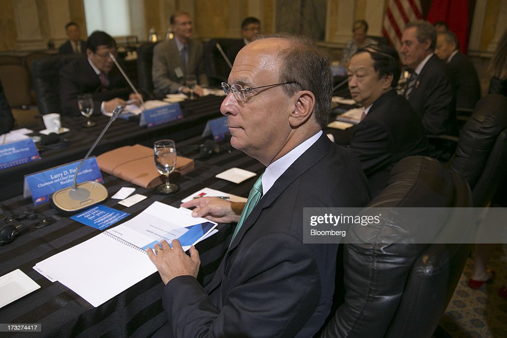 Laurence 'Larry' D. Fink, chairman, chief executive officer and co-founder of BlackRock Inc., attends a chief executive officer roundtable with U.S. and Chinese business leaders during the U.S.-China Strategic and Economic Dialogue (S&ED) conference at the Treasury Department in Washington, D.C., U.S., on Thursday, July 11, 2013. The U.S. and China are meeting this week to find ways to balance a wider flow of investment and goods as their central banks try to prevent excessive risk-taking from derailing the world's biggest economies. Photographer: Andrew Harrer/Bloomberg via Getty Images