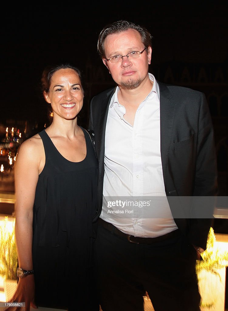 Laurence Lenica (R) and guest attend the Beijing International Film Festival (BJIFF) Organization Committee Reception during the 70th Venice International Film Festival at the Danieli Hotel - La Terrazza on August 31, 2013 in Venice, Italy.