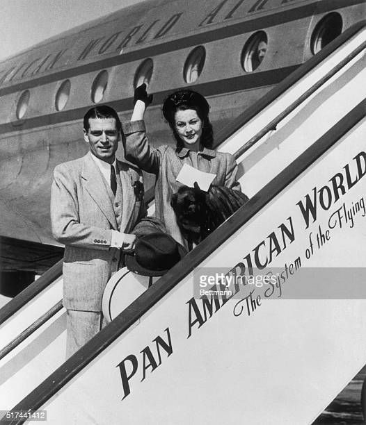 Laurence Olivier and his wife Vivien Leigh British stage and screen stars board a Pan American Constellation at LaGuardia Field June 18 Shortly after...