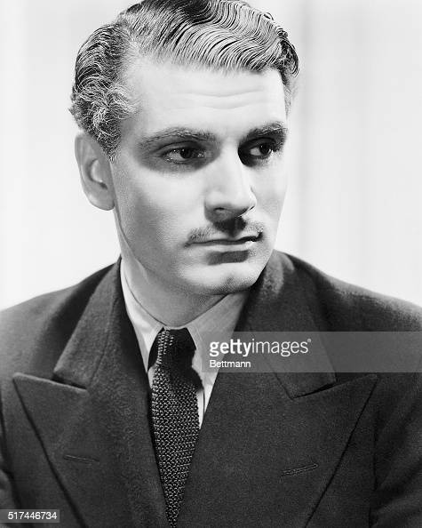Laurence Olivier popular British stage and screen star and member of The Old Vic is seen as the handsome dashing Maxim de Winter Lord of Manderley in...