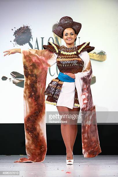 Laurence Roustandjee walks the runway and wears a chocolate dress made by stylist Audrey Lempeseur and chocolate maker Frederic Cassel during the...