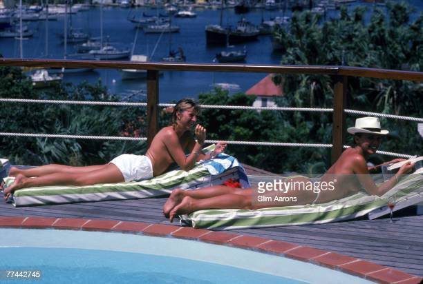 Laurence Thellin right sunbathing by the pool at L'Hibiscus Hotel St Barts March 1982