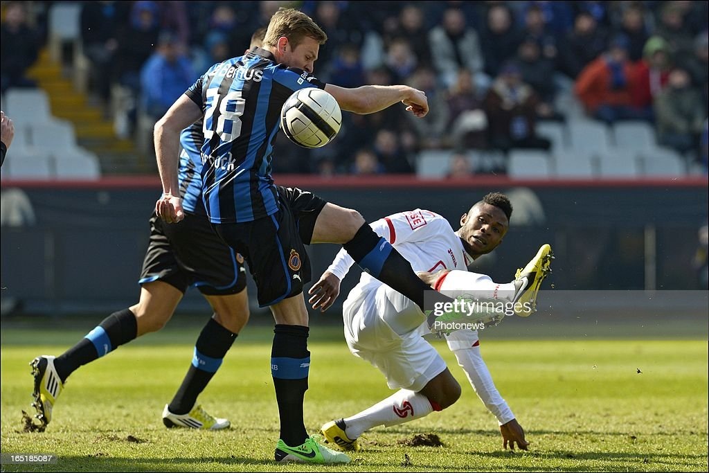 Laurens De Bock of Club Brugge KV battles for the ball with Imoh Ezekiel of Standard during the Jupiler League match between Club Brugge and Standard de Liege on April 01, 2013 in the Jan Breydel Stadium in Brugge, Belgium.