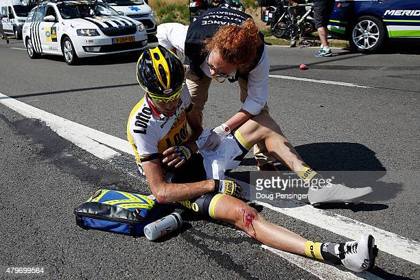 Laurens Ten Dam of the Netherlands riding for Team LottoNLJumbo is attended to by medial personel after being involved in a crash with 65km remaining...