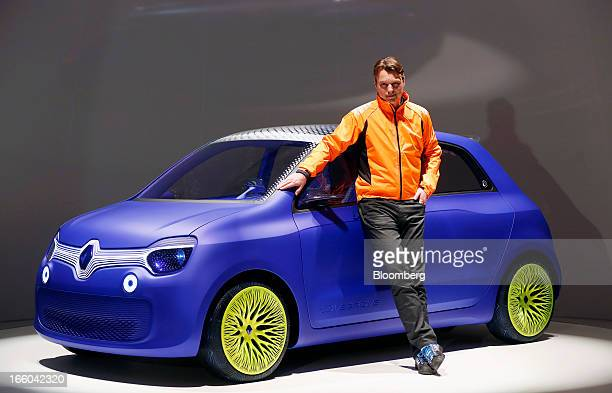 Laurens van den Acker senior vice president of corporate design at Renault SA stands alongside the Renault Twin'Z concept automobile designed by...