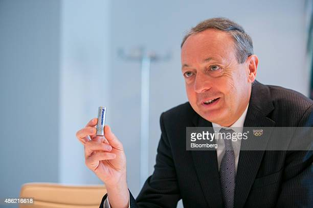 Laurent Abadie chief executive officer of Panasonic Europe holds a lithium ion battery during an interview at the Panasonic Corp exhibition stand...