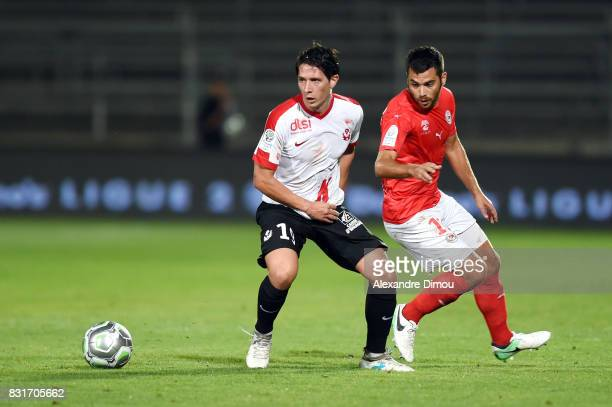 Laurent Abergel of Nancy and Tegi Savanier of Nimes during the Ligue 2 match between Nimes Olympique and As Nancy Lorraine at Stade des Costieres on...