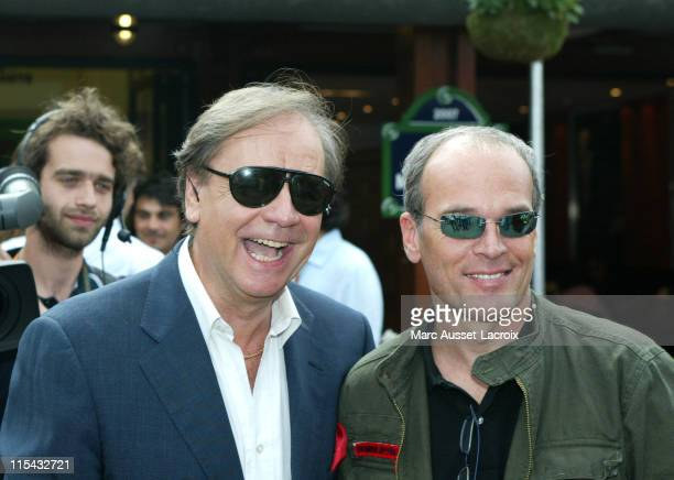 Laurent Baffie and Daniel Lauclair pose in the 'Village' the VIP area of the French Open at Roland Garros arena in Paris France on June 3 2007