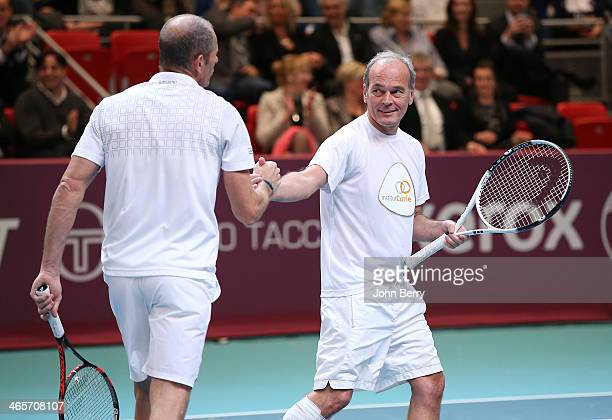 Laurent Baffie and Guy Forget in action during the Amelie Mauresmo Tennis Night to benefit the 'Institut Curie' to fight cancer during the 22nd Open...