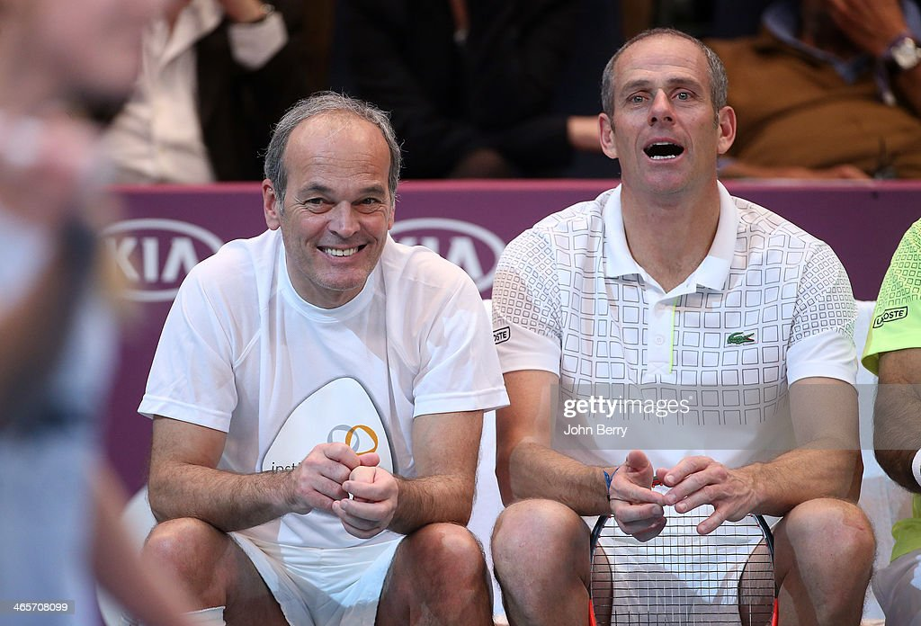 Laurent Baffie and Guy Forget look on during the Amelie Mauresmo Tennis Night to benefit the 'Institut Curie' to fight cancer during the 22nd Open...