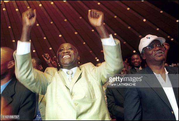 Laurent Bagboy FPI candidate for presidential elections in meeting in Abidjan Cote d'Ivoire on October 21 2000 Right A Sangare FPI general secretary