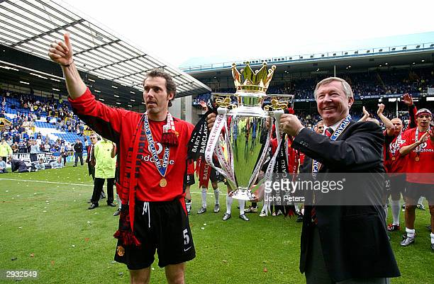 Laurent Blanc and manager Sir Alex Ferguson celebrate with the Barclaycard Premiership trophy after the FA Barclaycard Premiership match between...