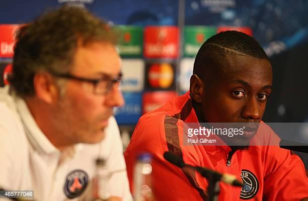 Laurent Blanc manager of Paris SaintGermain and midfielder Blaise Matuidi look on during a Paris SaintGermain press conference ahead of the UEFA...