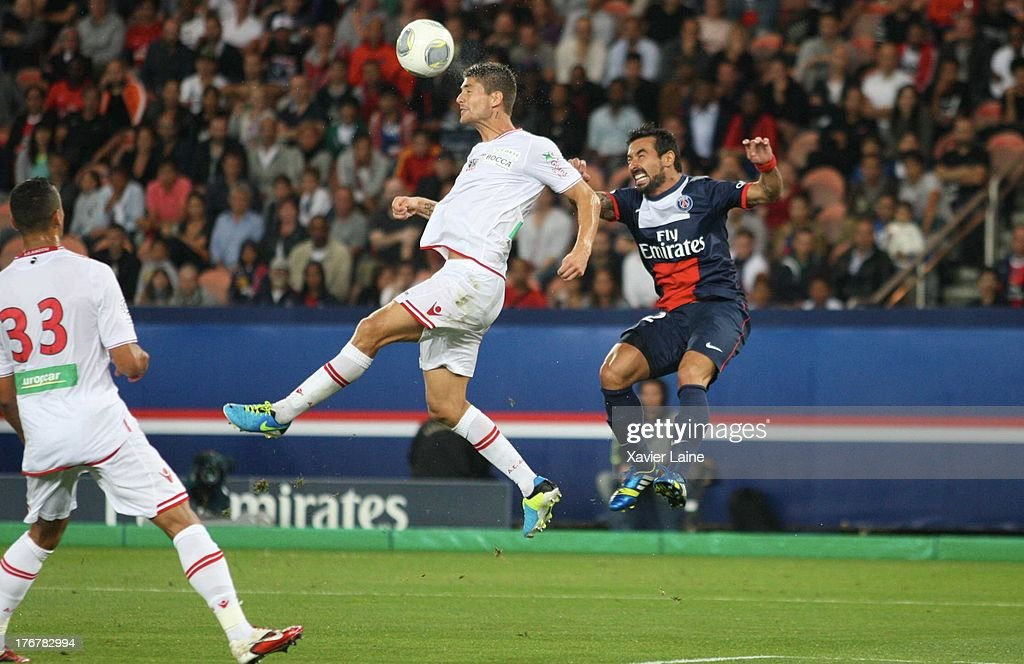 Laurent Bonnard of Ajaccio AC and <a gi-track='captionPersonalityLinkClicked' href=/galleries/search?phrase=Ezequiel+Lavezzi&family=editorial&specificpeople=5451126 ng-click='$event.stopPropagation()'>Ezequiel Lavezzi</a> of Paris Saint-Germain in action during the French League 1 between Paris Saint-Germain FC and AC Ajaccio, at Parc des Princes on August 18, 2013 in Paris, France.