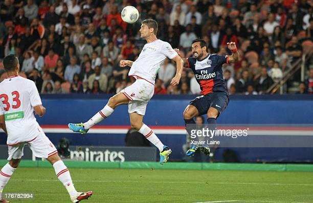 Laurent Bonnard of Ajaccio AC and Ezequiel Lavezzi of Paris SaintGermain in action during the French League 1 between Paris SaintGermain FC and AC...