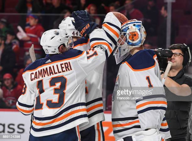 Laurent Brossoit and Michael Cammalleri of the Edmonton Oilers celebrate after defeating the Montreal Canadiens in the NHL game at the Bell Centre on...
