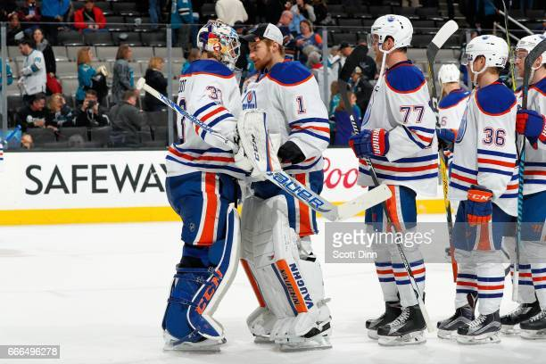 Laurent Brossoit Cam Talbot of the Edmonton Oilers react to the Oilers win after a NHL game against the San Jose Sharks at SAP Center at San Jose on...