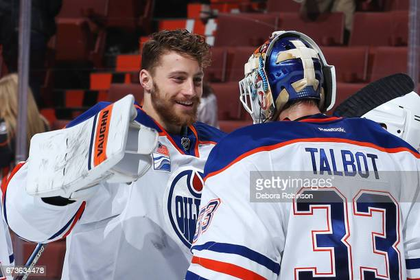 Laurent Brossoit congratulates Cam Talbot of the Edmonton Oilers following their win over the Anaheim Ducks in Game One of the Western Conference...