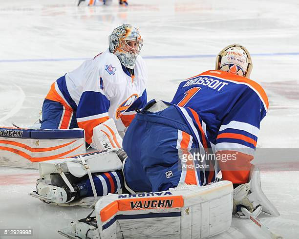 Laurent Brossoit of the Edmonton Oilers exchanges words with Thomas Greiss the New York Islanders on February 28 2016 at Rexall Place in Edmonton...