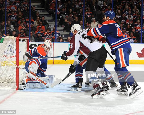 Laurent Brossoit of the Edmonton Oilers makes a save on a shot from Cody McLeod of the Edmonton Oilers on March 20 2016 at Rexall Place in Edmonton...