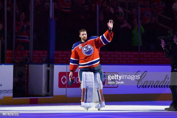 Laurent Brossoit of the Edmonton Oilers salutes the crowed after being selected the first star of the game against the Colorado Avalanche on March 25...