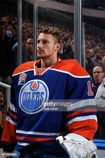Laurent Brossoit of the Edmonton Oilers stands for the singing of the national anthem prior to the game against the Carolina Hurricanes on October 18...